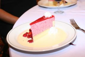 Charlotte aux Cassis surrounded by fruits and Creme Anglaise