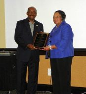 (Right:) Betty Edwards receives the M. Cecil Padgett Outstanding Achievement Award