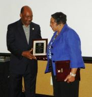 (Right:) Betty Edwards surprised to receive the Award for Outstanding Service