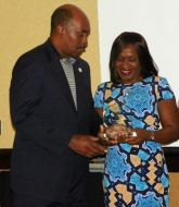 (Right:) Dr. Regina Okeowo receives award.